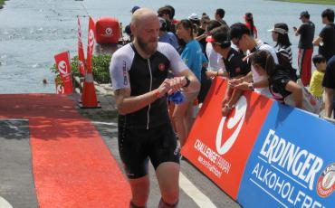 image of martin mckinlay checking his watch in Triathlon transition